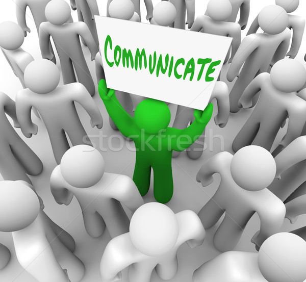 Communicate Person Holds Sign Get Attention of Crowd People Stock photo © iqoncept