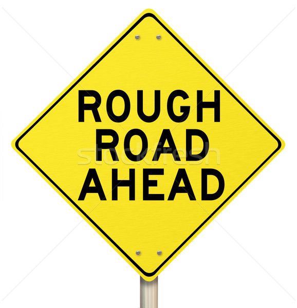 Yellow Warning Sign - Rough Road Ahead - Isolated Stock photo © iqoncept