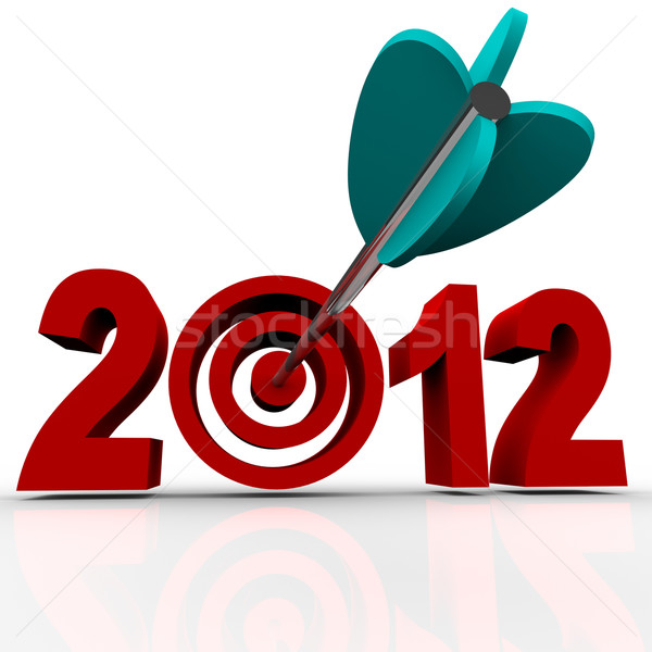Year 2012 in Red Numbers with Arrow in Target Bulls-Eye Stock photo © iqoncept