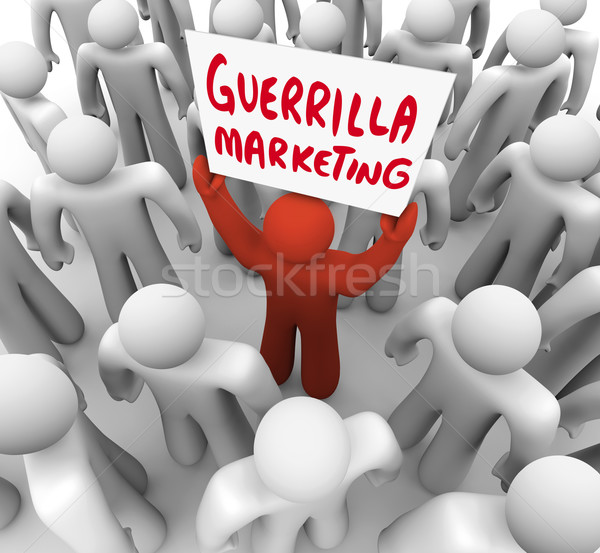 Guerrilla Marketing Man Holding Sign Advertising Tactics Stock photo © iqoncept