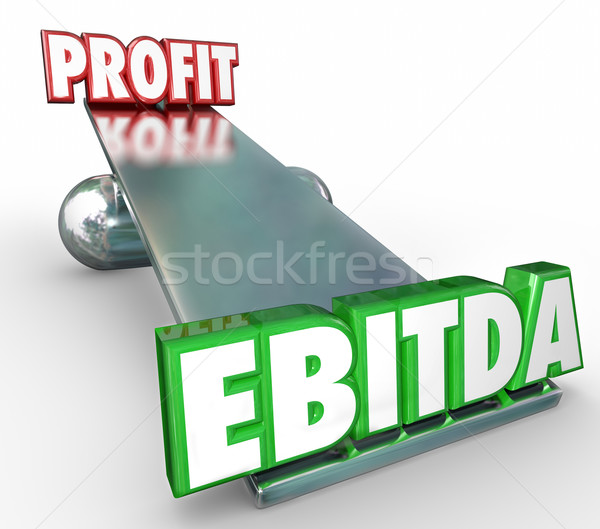 EBITDA vs Profit Words 3d Letters Scale Balance Weighing Account Stock photo © iqoncept