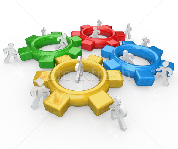 Team of People Push Gears Together Teamwork Success Stock photo © iqoncept