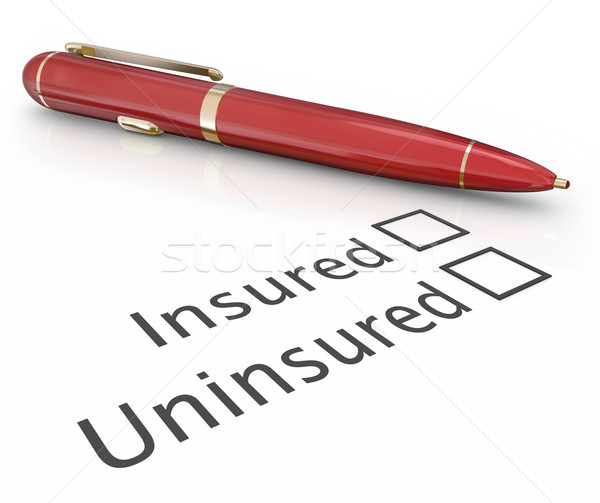 Insured vs Uninsured Pen Checking Box Medical Insurance Coverage Stock photo © iqoncept