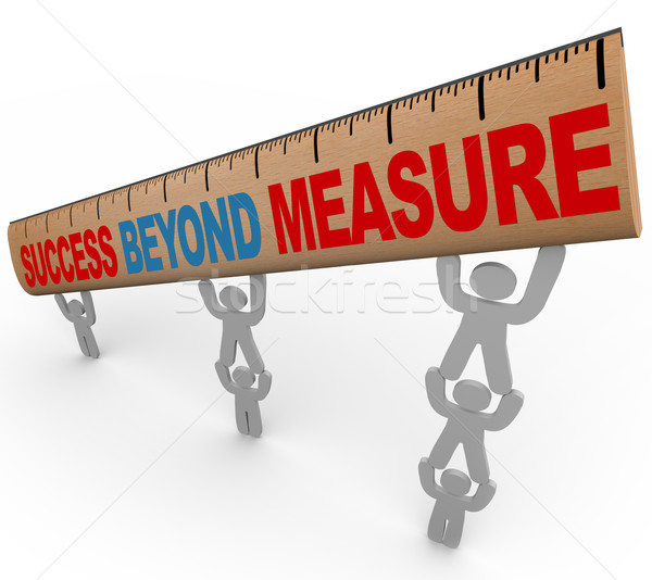 Success Beyond Measure - Team Lifting Ruler Stock photo © iqoncept