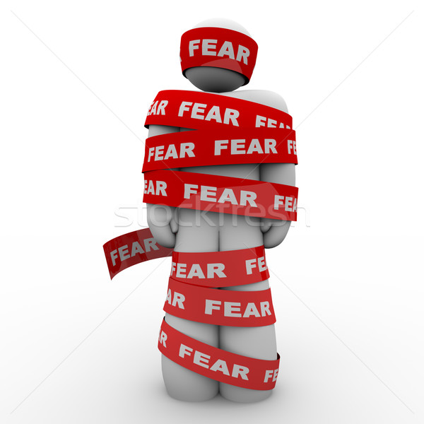Scared Afraid Man Wrapped in Red Fear Tape Stock photo © iqoncept