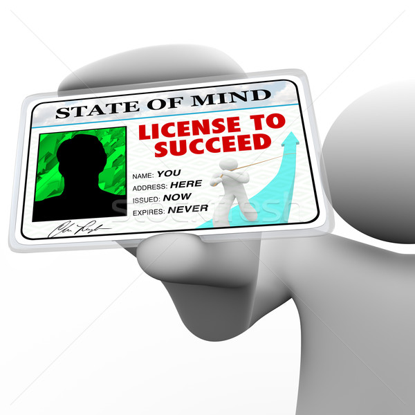 License to Succeed - Successful Man Holding Special Badge Stock photo © iqoncept