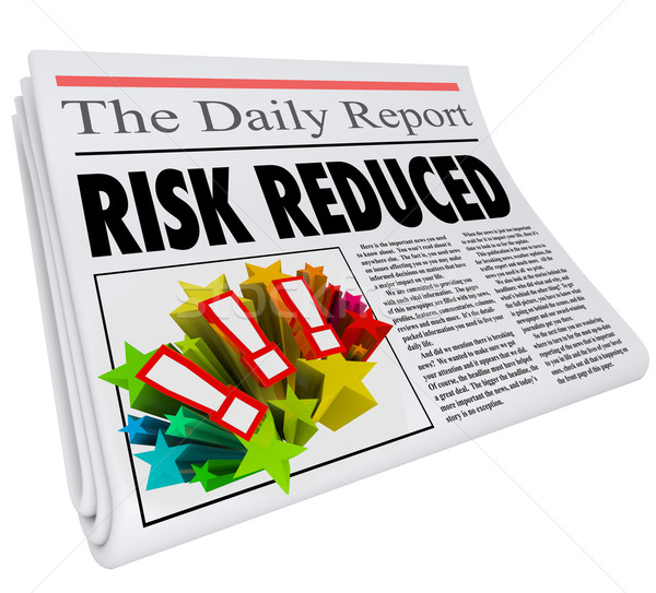 Risk Reduced Newspaper Headline Lower Danger Level Stock photo © iqoncept