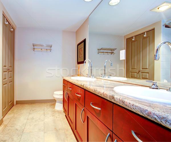 Classic bathroom with cherry  cabinets. Stock photo © iriana88w