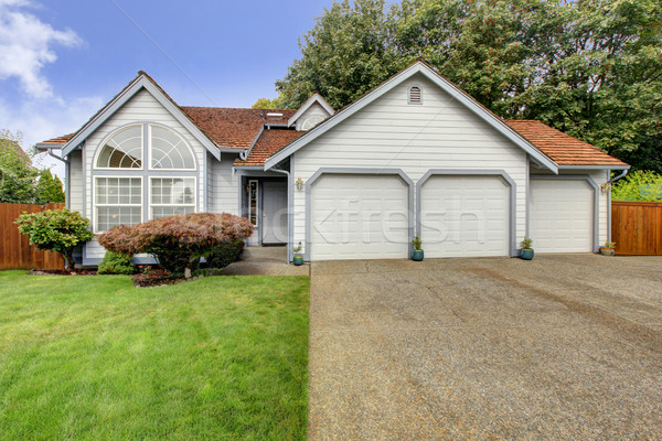 House with large arch window and three car garage Stock photo © iriana88w