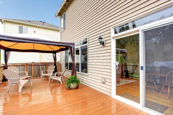 Ház hát veranda esernyő székek eső Stock fotó © iriana88w