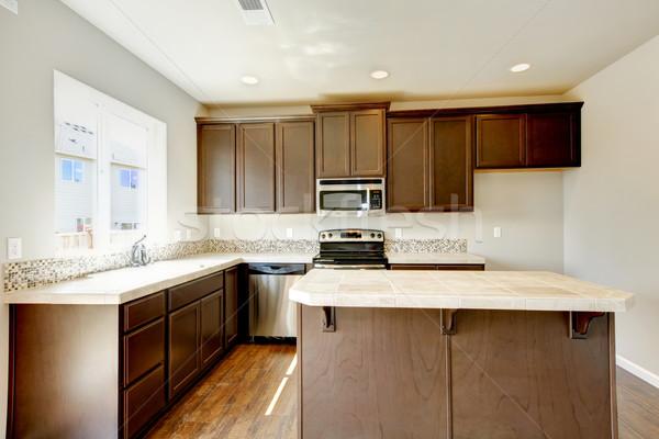 Nieuw huis keuken interieur donkere bruin hardhout vloeren Stockfoto © iriana88w