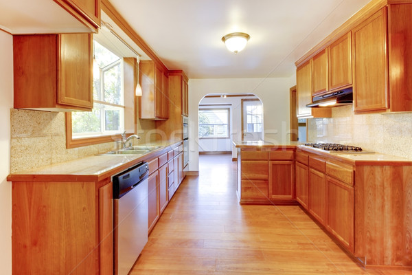 Sunny brown kitchen interior with hardwood floor and white ceili Stock photo © iriana88w