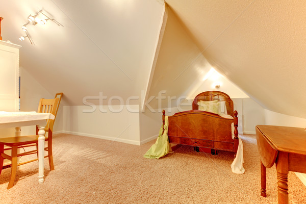 Attic bedroom with desk and small bed. Stock photo © iriana88w