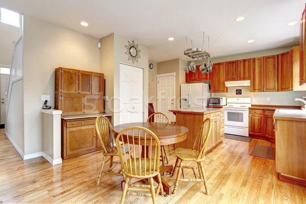 Classic large wood kitchen interior with hardwood floor. Stock photo © iriana88w