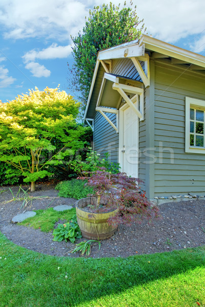 Grey small outdoor shed with backyard landscape. Stock photo © iriana88w