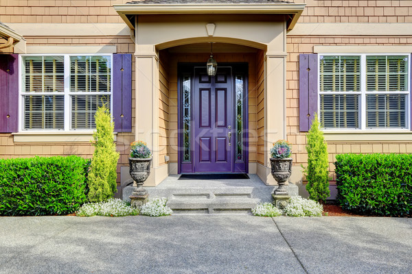Luxury house exterior. Entrance porch with purple door Stock photo © iriana88w