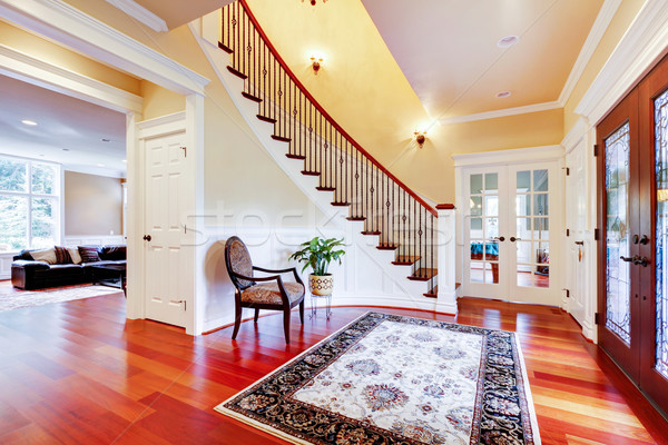 Luxury home entrance with cherry hardwood floor and staircase. Stock photo © iriana88w