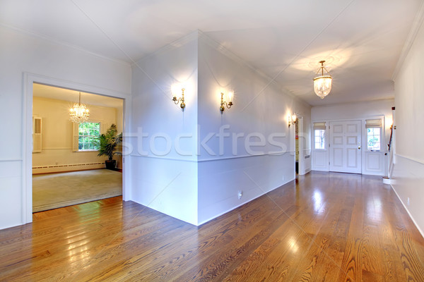 Large bright hallway with hardwood floor and dining room. Stock photo © iriana88w