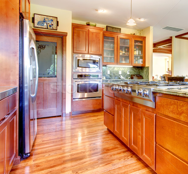 Luxury cherry wood kitchen interior with hardwood. Stock photo © iriana88w