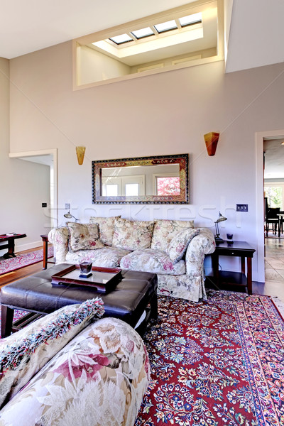 Living room with high ceiling with red rug and sofas. Stock photo © iriana88w