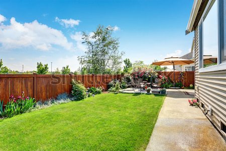Large house back yard with two decks and flower boxes. Stock photo © iriana88w