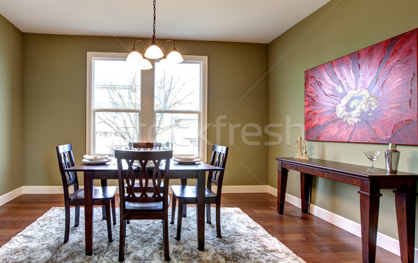 Dining room with green walls and red painting. Stock photo © iriana88w