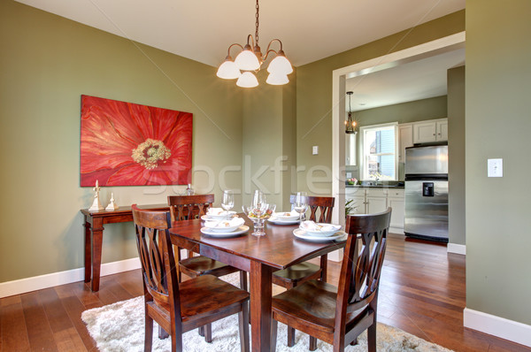 Dining room with green walls and cherry floor. Stock photo © iriana88w