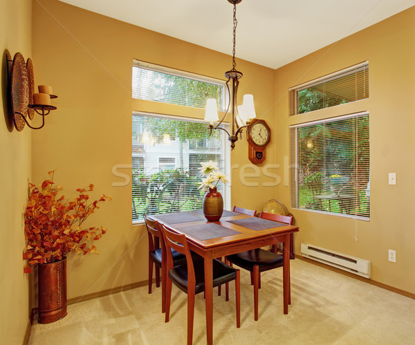 Warm dinning room with carpet and windows. Stock photo © iriana88w