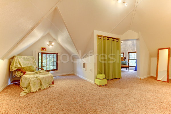 Attic room with chair, mirror and play room with clothes. Stock photo © iriana88w