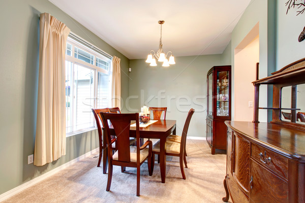 Stock photo: Green dining room interior with classic brown furniture.