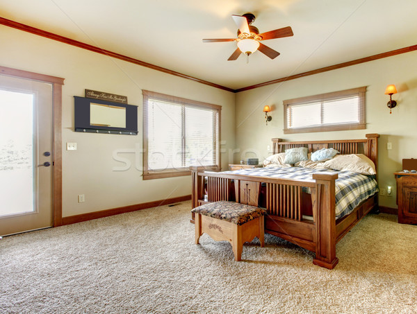 Stock photo: Natural cabin farm house bedroom with beige carpet and green walls.