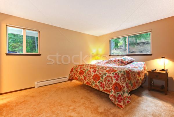 Beautiful beige bedroom with colourful bedding, nightstand. Stock photo © iriana88w