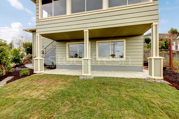 Grey green newly remodeled two level house exterior. Stock photo © iriana88w