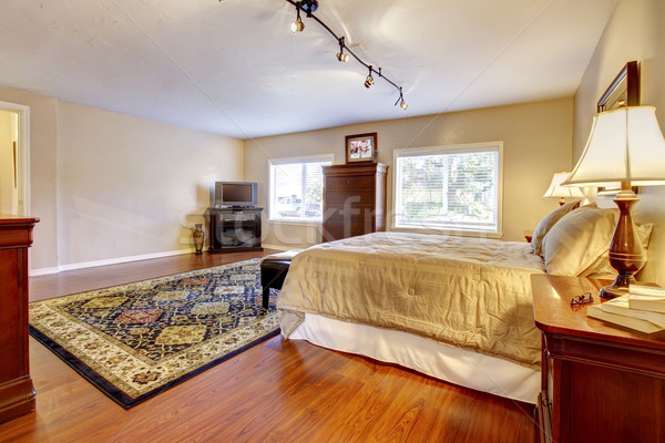 Large bedroom with hardwood floor and two dressers. Stock photo © iriana88w
