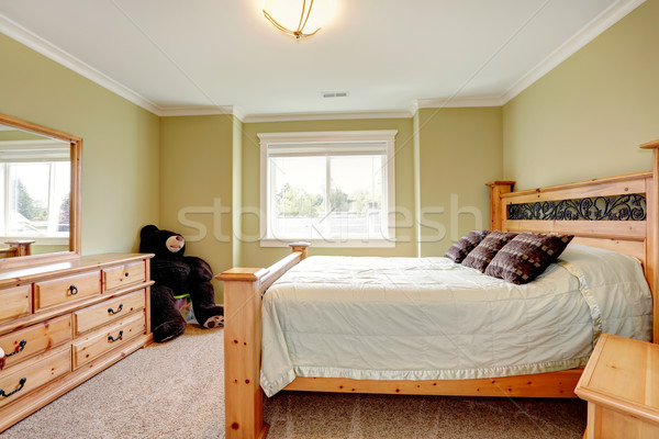 Cozy lime bedroom with big toy bear Stock photo © iriana88w