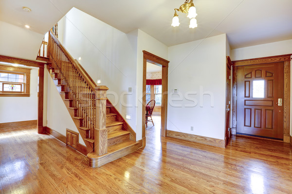 Empty entrance hallway with wooden staircase Stock photo © iriana88w