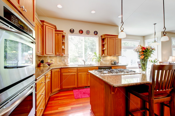 Wood luxury large kitchen with red and granite. Stock photo © iriana88w