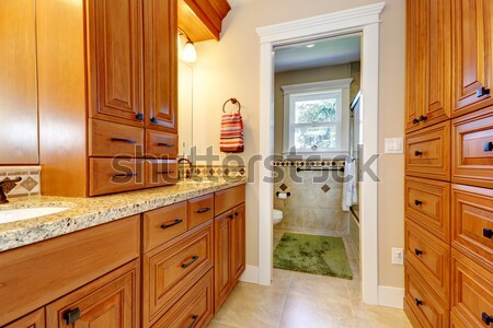Laundry room with wood storage cabinets. Stock photo © iriana88w