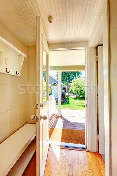 Beige walls hallway with open door and hardwood floor. Stock photo © iriana88w