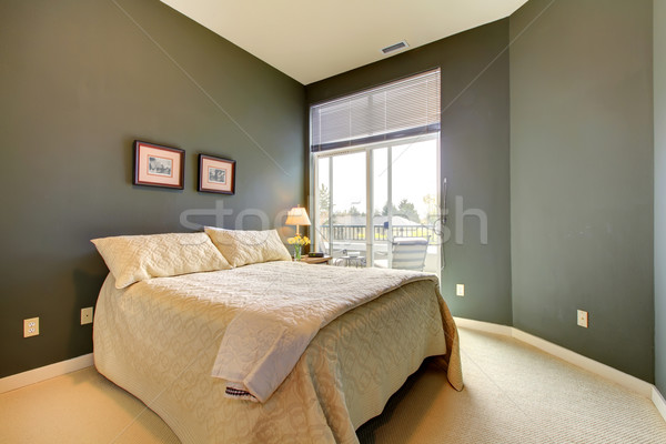 Bedroom wiht grey green walls and white bedding. Stock photo © iriana88w