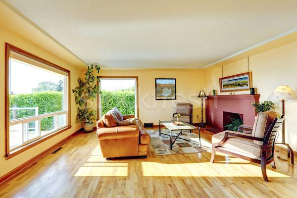 Stok fotoğraf: Oturma · odası · kırmızı · tuğla · şömine · geniş