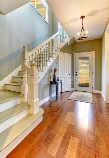 Stock photo: Home interior hallway with staircase and green walls.