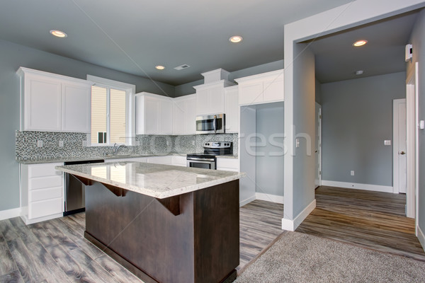 Unique kitchen with gray hardwood floor. Stock photo © iriana88w