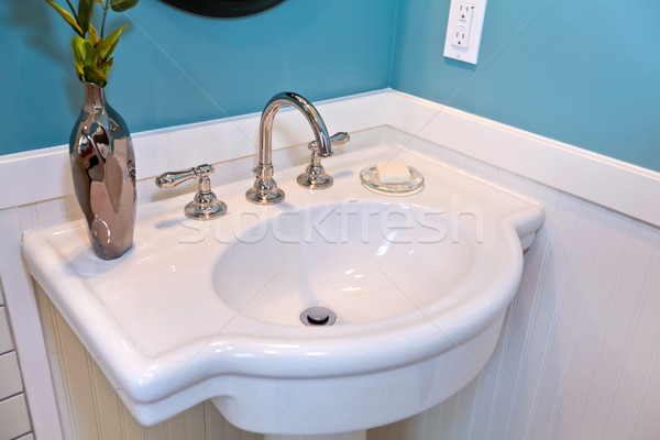 Beautiful white sink with blue walls and plank wall trim. Stock photo © iriana88w