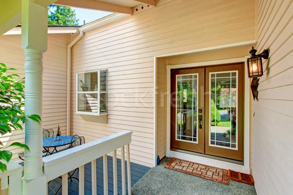 Bejárat veranda üveg ajtó ül ház Stock fotó © iriana88w