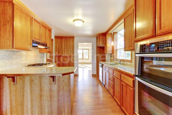 Marrom interior da cozinha piso de madeira polido casa parede Foto stock © iriana88w