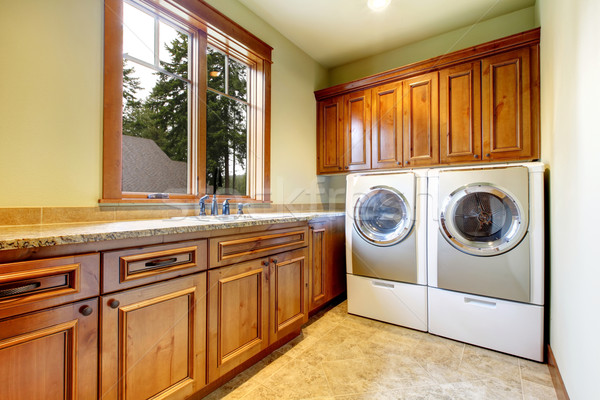 Stock photo: Luxury laundry room with wood cabinets.