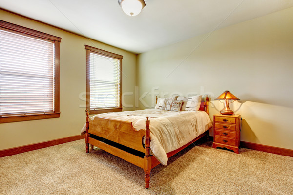 Stock photo: Natural farm house bedroom  with beige carpet and green walls.