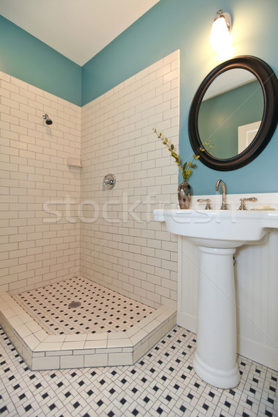 White and blue bathroom with washbasin stand and open shower. Stock photo © iriana88w