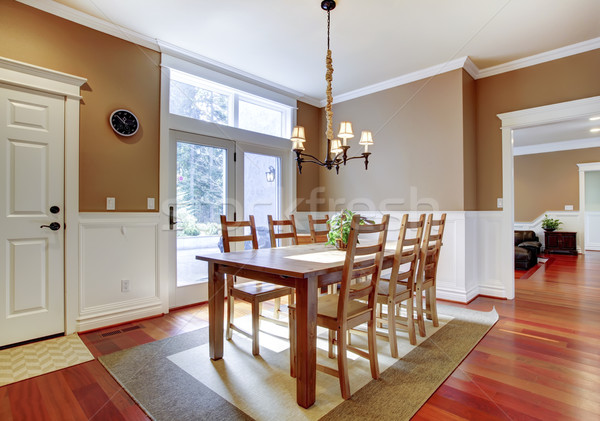 Large bright beige dining room with cherry hardwood. Stock photo © iriana88w